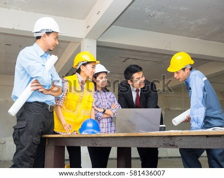 Engineer group worker meeting discussion construction stock photo engineer group and worker meeting discussion with construction blueprint on site work malvernweather Images