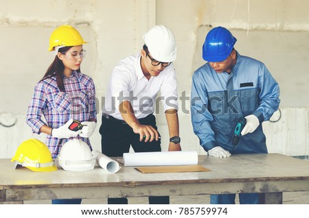 Engineer group worker meeting discussion construction stock photo engineer group and worker meeting discussion with construction blueprint on site work and point finger malvernweather Image collections