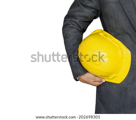 Engineer hand holding yellow helmet for workers security isolated on white