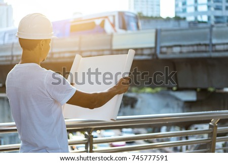 Engineer hold security helmet blueprint paper stock photo engineer hold security helmet and blueprint paper construction drawing plan on a building site malvernweather Image collections