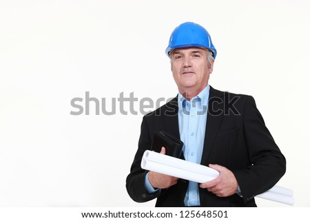 Engineer holding a rolled-up blueprint and an agenda - stock photo