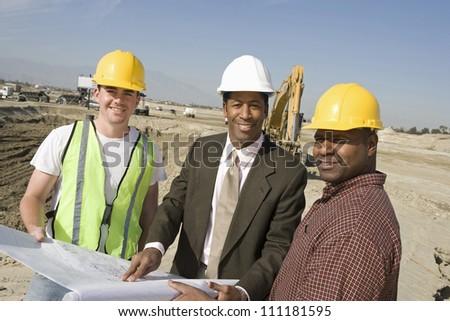 Engineer holding blueprint - stock photo
