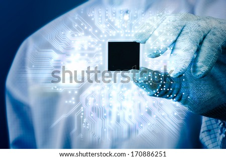 engineer holding electronics chip and electronics circuit glow in blue tone - stock photo
