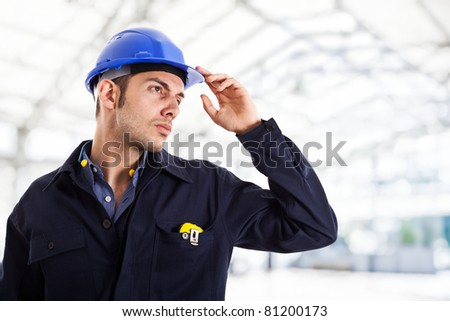 Engineer in a construction site - stock photo