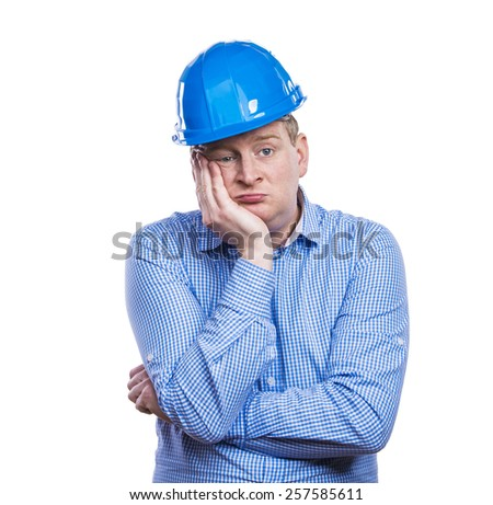 Engineer in blue hard hat. Studio shot on white background. - stock photo