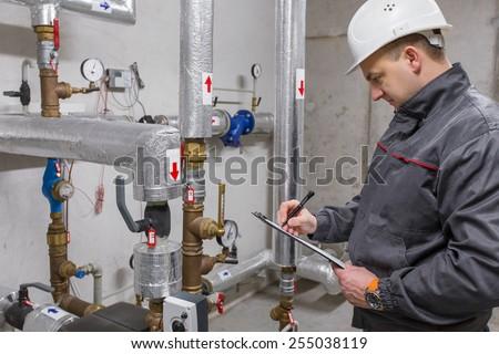Engineer in boiler room - stock photo