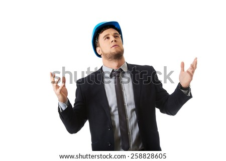 Engineer in hard hat holding copyspace in both hands. - stock photo