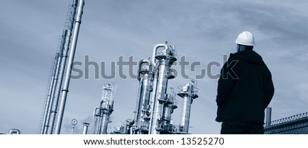 engineer in hard-hat looking at oil and gas industry, panoramic concept - stock photo