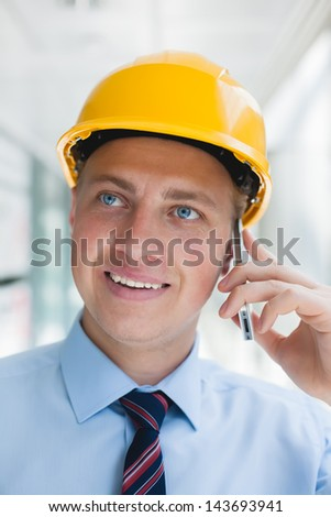 engineer in hard hat talking on the phone