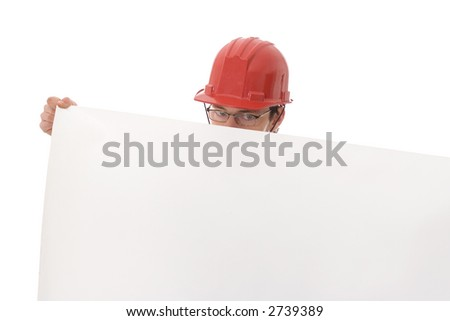 Engineer in red hat, showing a blank white paper