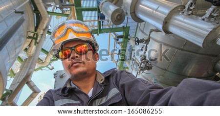 Engineer in refinery plant - stock photo