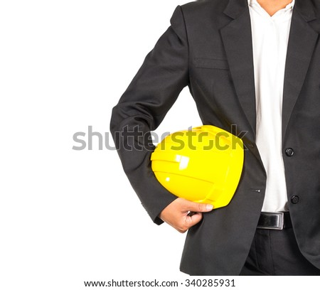 engineer in suit holding yellow helmet for workers security on white background, include clipping path, industrial concept - stock photo
