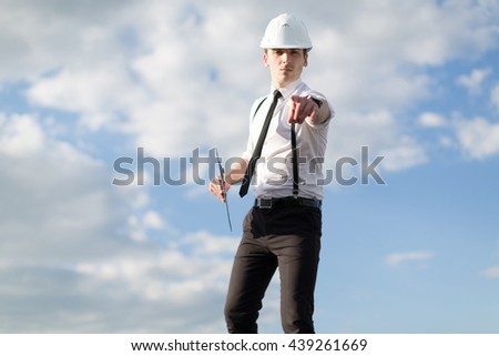 Engineer in the helmet on a roof