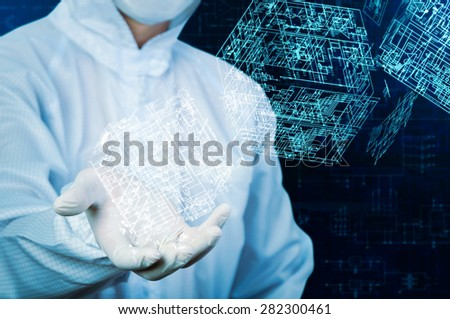 Engineer in working suit holding cubical electronics circuit - stock photo