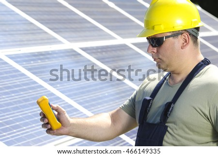 Engineer is measuring solar insolation on the solar panel