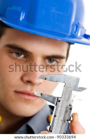 Engineer looking at a caliper - stock photo