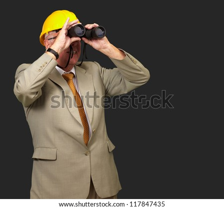 Engineer Looking Away On Black Background - stock photo