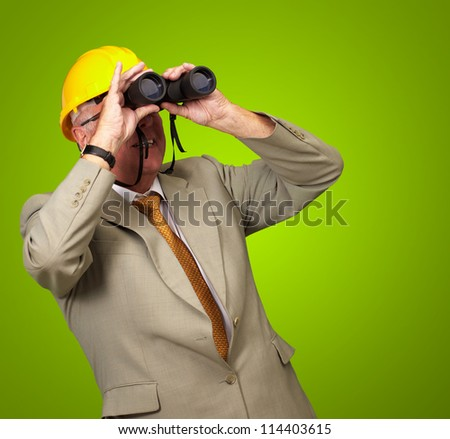 Engineer Looking Away On Green Background - stock photo
