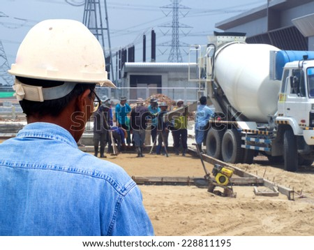 engineer looking work in front of construction site                  - stock photo
