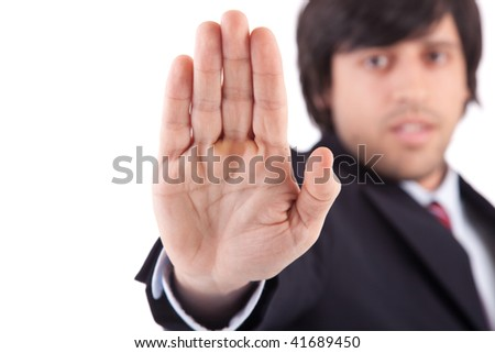 Engineer making stop sign - focus on hand - stock photo
