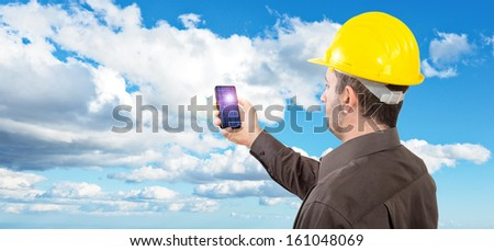 Engineer observes a photovoltaic cell in the sunlight. Concept renewable energy generation - stock photo