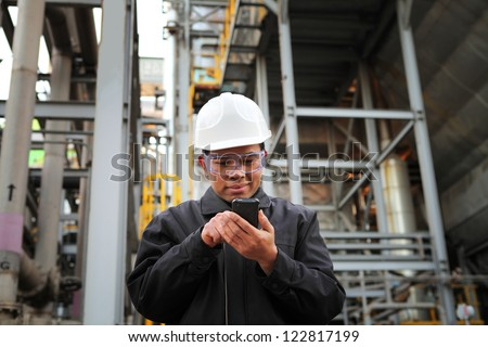 engineer oil refinery communicate via mobile phone - stock photo