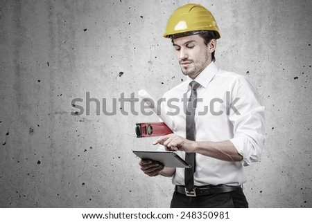 Engineer on construction site working with a touch-pad - stock photo