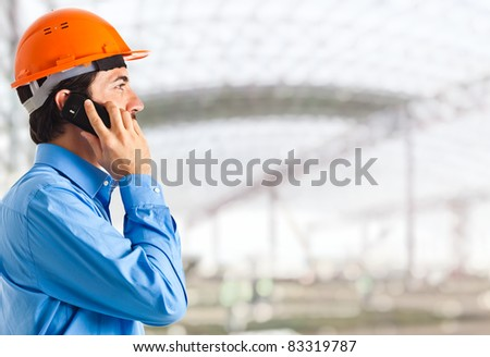 Engineer on the phone in an establishment - stock photo