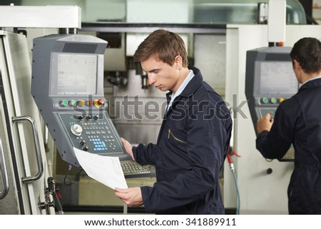 Engineer Operating Computerized Cutting Machine