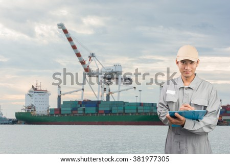 Engineer or technician write book with cargo port shipping background