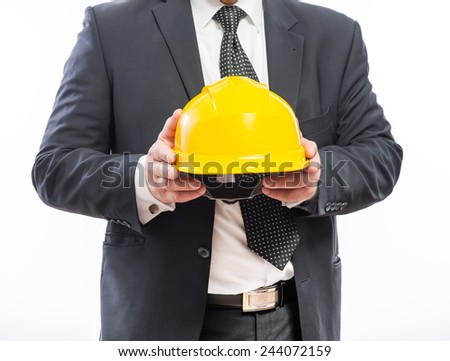 engineer or worker hand holding yellow helmet  - stock photo