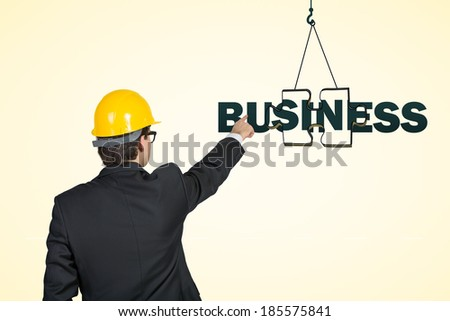 Engineer pointing out the business building - stock photo