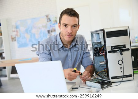 Engineer proceeding to data recovery from computer - stock photo