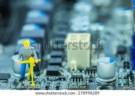 engineer repairing circuit mother board. Computer repair concept - stock photo