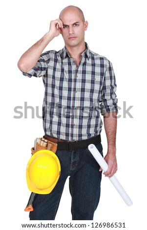 Engineer scratching his bald head - stock photo
