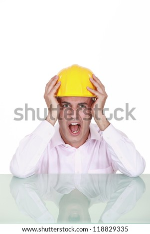 Engineer screaming in anger - stock photo
