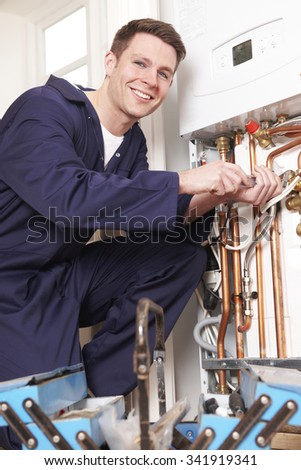 Engineer Servicing Central Heating Boiler - stock photo