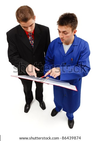 Engineer showing something on project notebook to businessman - stock photo