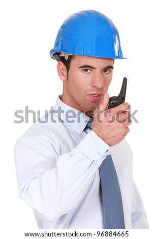 Engineer speaking into his walkie-talkie