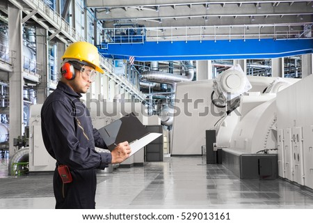 Engineer taking notes for maintenance work  in thermal power plant factory