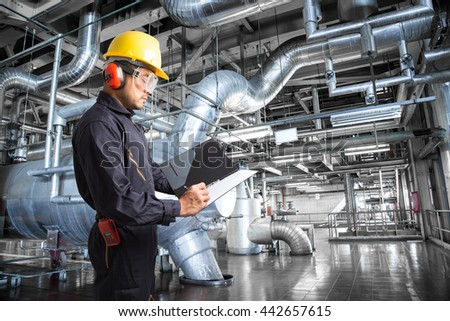 engineer taking notes in thermal power plant factory - Power Plant Engineer