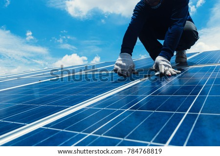 engineer team working on replacement solar panel in solar power plant;engineer and electrician team swapping and install solar panel after solar panel voltage drop