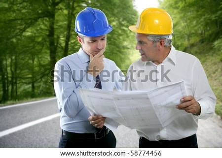 engineer two expertise team plan talking hardhat forest road [Photo Illustration] - stock photo