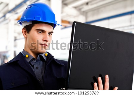 Engineer using a laptop computer - stock photo
