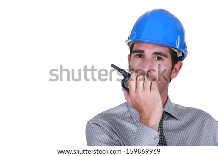 Engineer using a walkie-talkie - stock photo