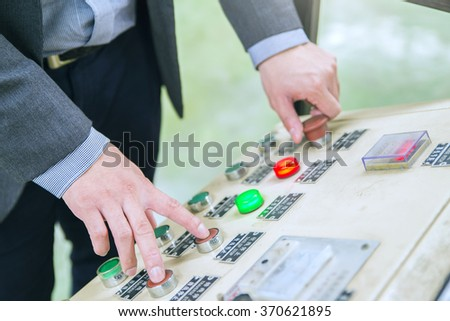 Engineer  Using Automated  Machine And manufacturing Wire - stock photo