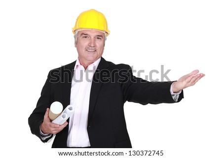Engineer welcoming a client - stock photo