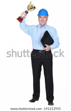 Engineer with a gold cup - stock photo