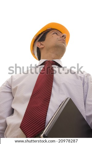 Engineer with a yellow hardhat and computer isolated on white - stock photo