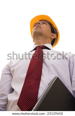 Engineer with a yellow hardhat and computer isolated on white